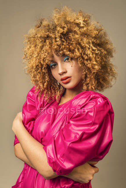 Portrait of attractive retro woman with curly hair in pink blouse — Stock Photo