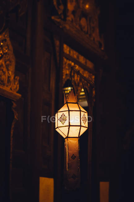 Traditional lantern with ornaments hanging at night, Thailand — Stock Photo