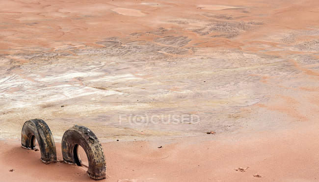 Dry brown rock surface in cracks with tires — Stock Photo