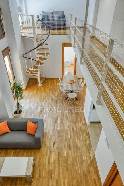 Empty duplex apartment in simple minimalist style with modern cozy furniture — Stock Photo