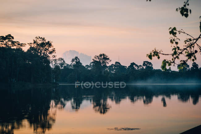 Landscape of tranquil lake water with haze above in sunrise hours, Thailand — Stock Photo
