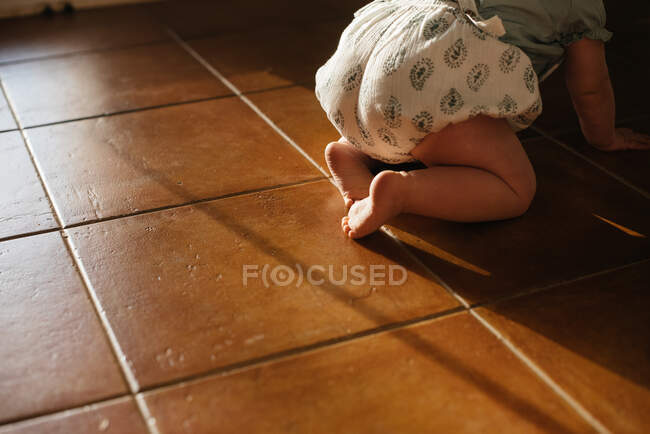 Baby crawling on all fours on floor — Stock Photo