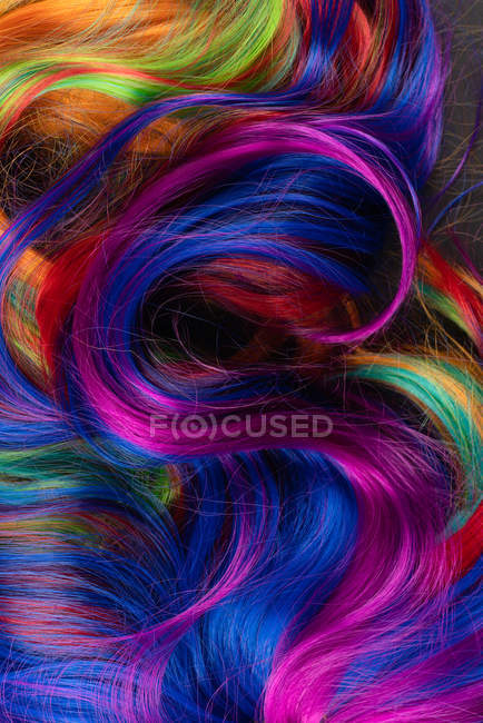 Background of multicolored vibrant soft hair locks in mess — Stock Photo