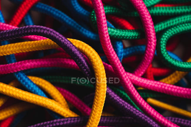 Background of messy mixed colorful shoelaces — Stock Photo