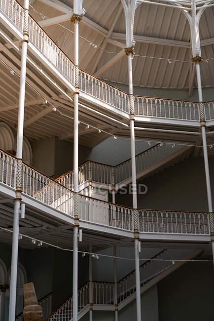 Amazing building architecture wooden stairways with wonderful columns — Stock Photo