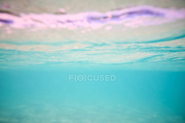 Turquoise depth under clear flawless calm water — Stock Photo