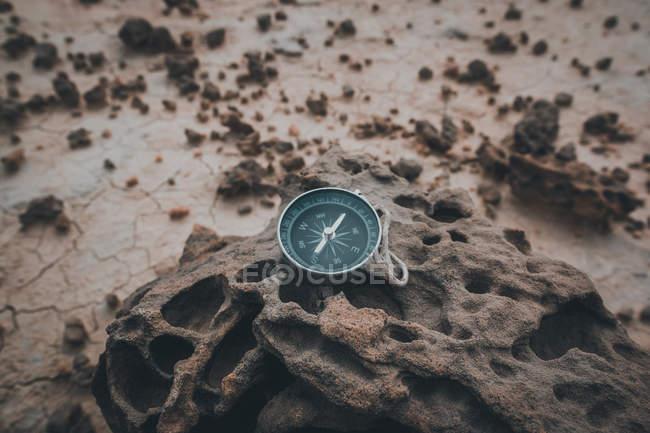 Compass on dry cracked desert area — Stock Photo