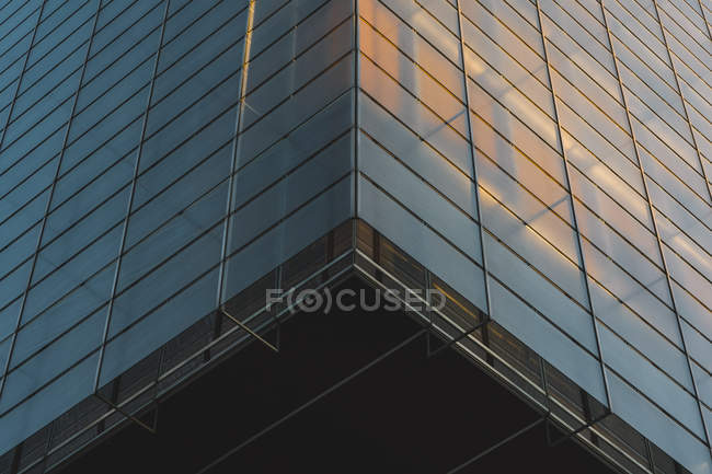From below glass walls of skyscraper in evening — Stock Photo