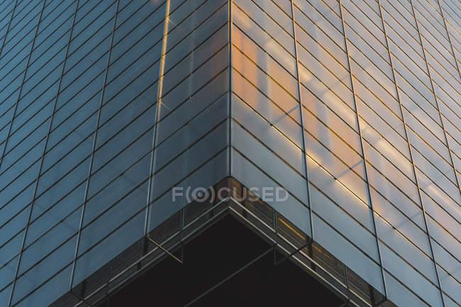 From below glass walls of skyscraper in evening — Stock Photo
