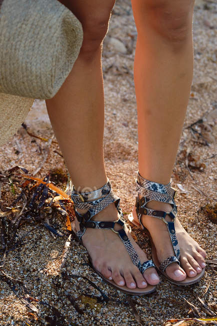 Closeup of stylish summer shoes on young female feet — Stock Photo