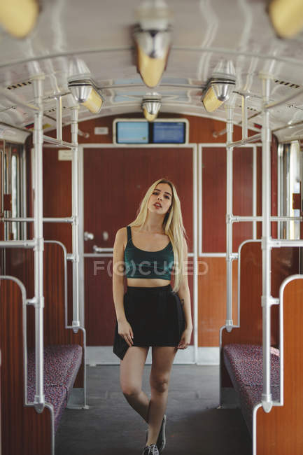 Young blonde woman posing in train car in Berlin — Stock Photo