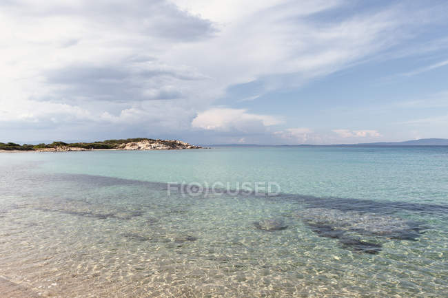 Picturesque view of rocky island and sea bottom on sunny summer day in Halkidiki, Greece — стокове фото