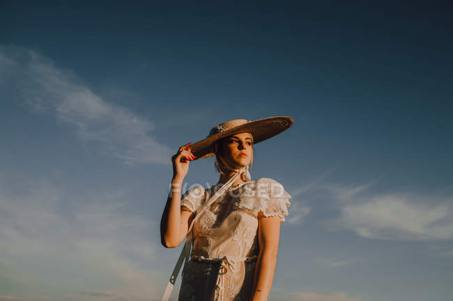 Beautiful stately woman in hats in bright sunny day — Stock Photo