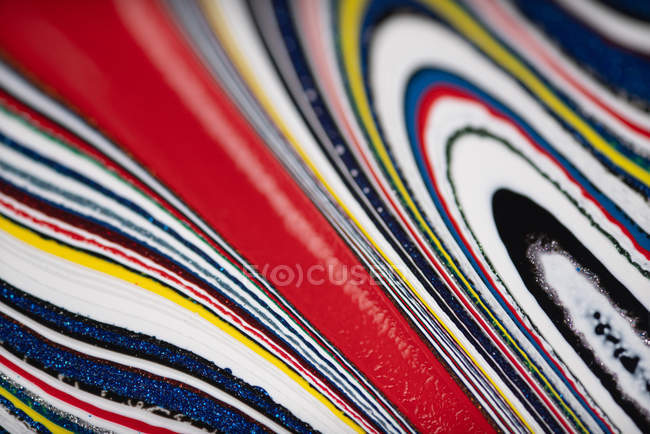 Background of colorful textured bright fordite — Stock Photo