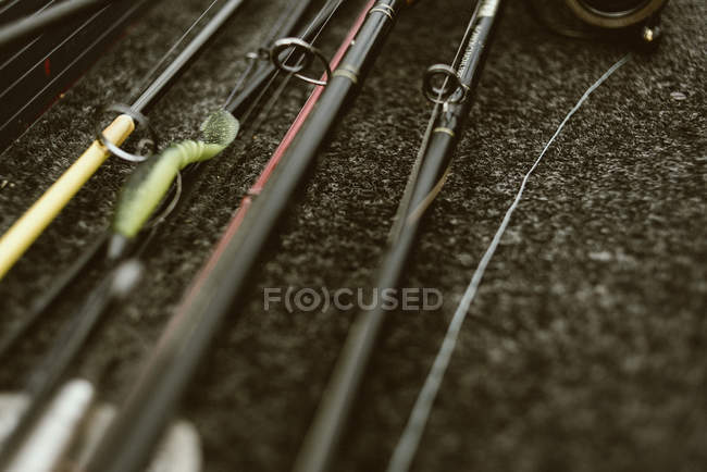 Closeup of fishing equipment with fishing rods on ground — Stock Photo