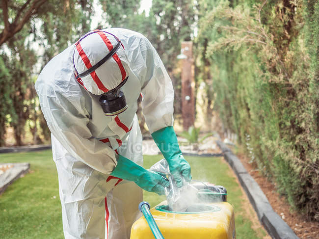 Fumigation specialist putting package into yellow device — Stock Photo