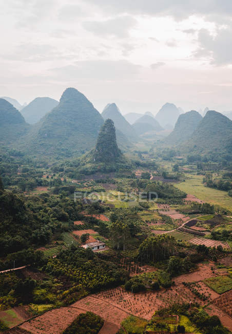 Coastal town surrounded with rocky mountains — Stock Photo