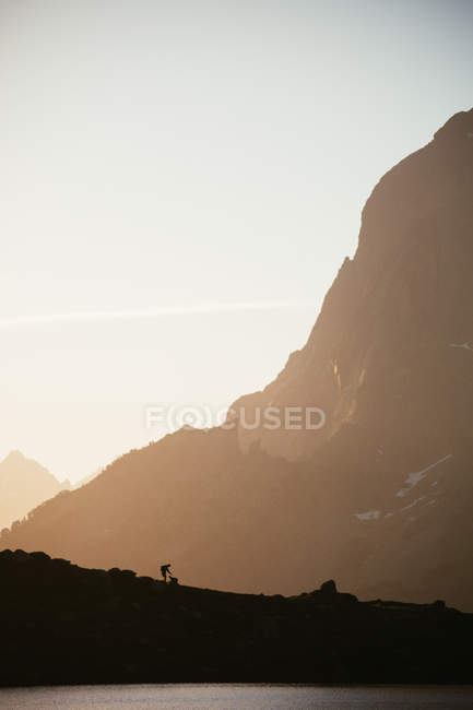 Majestic mountain landscape with human silhouette — Stock Photo
