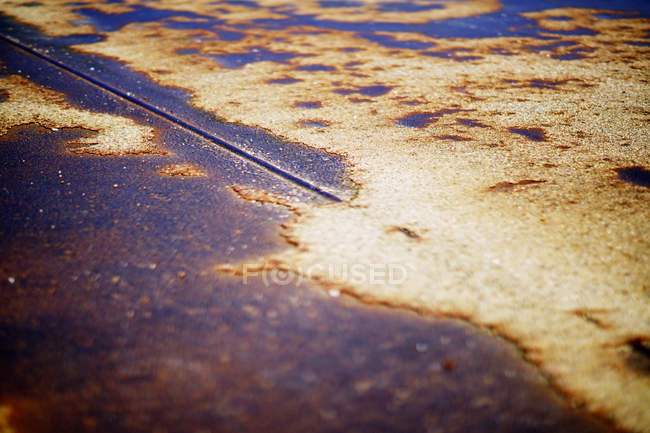 Closeup of rusty iron surface with corrosion spots and traces of old paint — Stock Photo