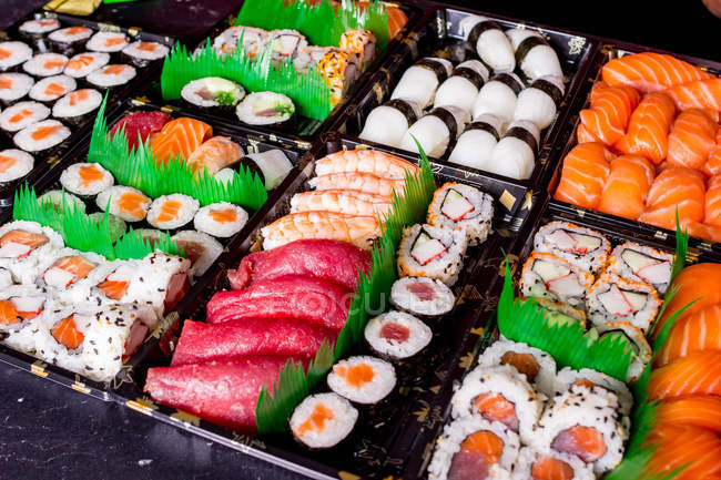 Appetizing delicious set of colorful sushi served on table in restaurant. — Stock Photo