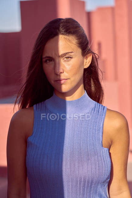 Close-up of beautiful woman in blue dress looking at camera — Stock Photo