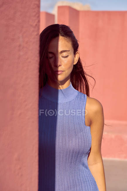 Close-up of beautiful woman in blue dress with closed eyes — Stock Photo