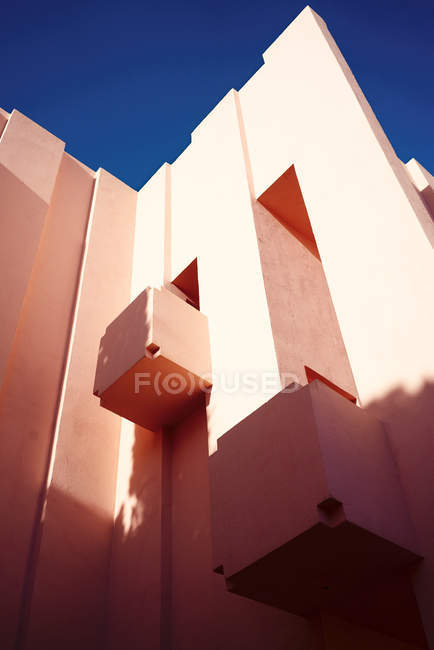 Traditional construction of pink building with balconies — Stock Photo