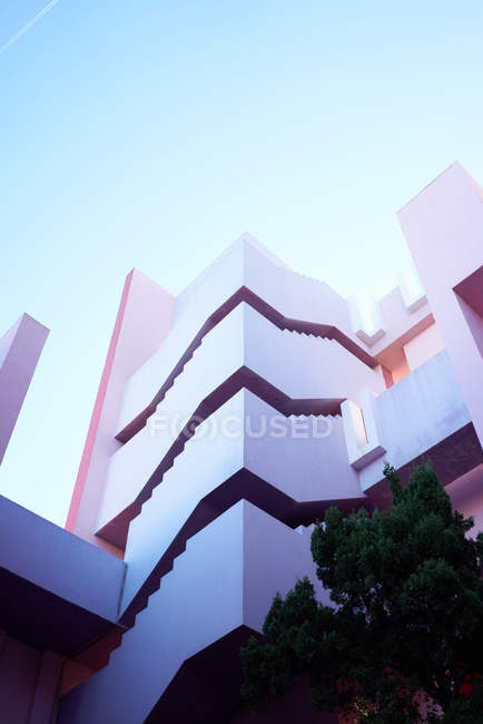 Traditional construction of pink building with stairs — Stock Photo