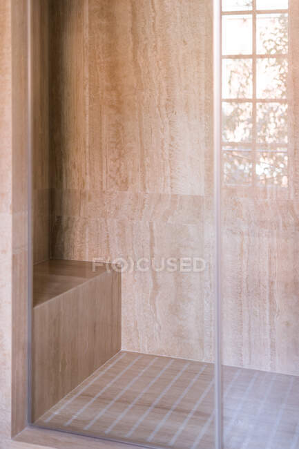 Stylish shower cabin from glass and with marble tile in contemporary house — Stock Photo