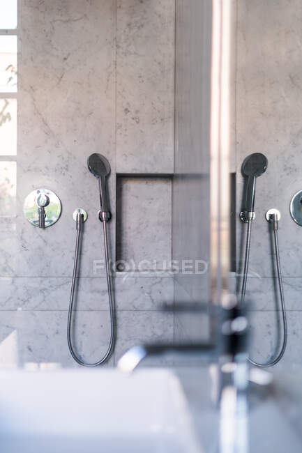 Chrome shiny shower tap and holder in marble cabin in luxury house — Stock Photo