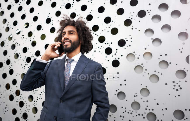 Presentable african american businessman during phone conversation — Stock Photo