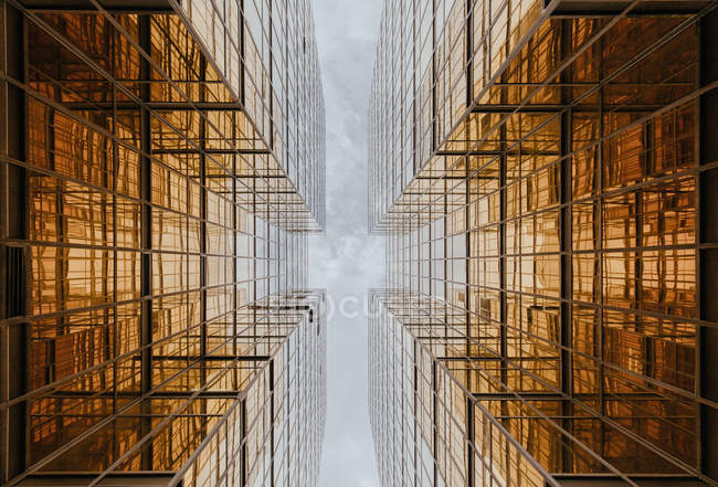 Buildings reflecting each other in wide windows — Stock Photo