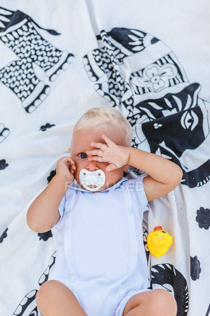 Portrait of a blonde baby with sleep expression — Stock Photo