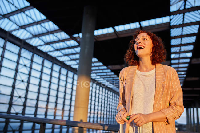 Smiling attractive young woman at station — Photo de stock