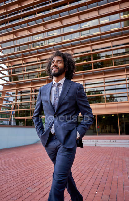 African american businessman standing at street — Stock Photo