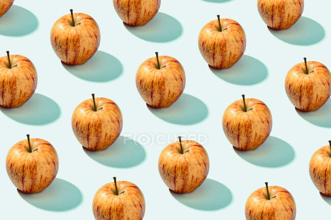 From above ripe tasty red orange apples on white surface — Stock Photo