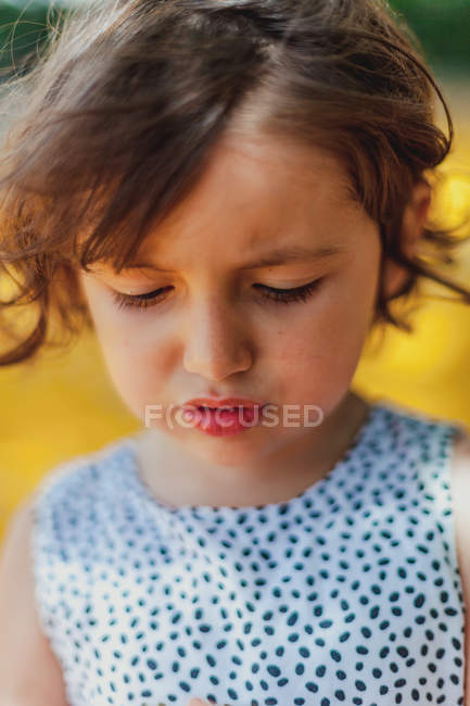 Active charming kid looking down — Stock Photo