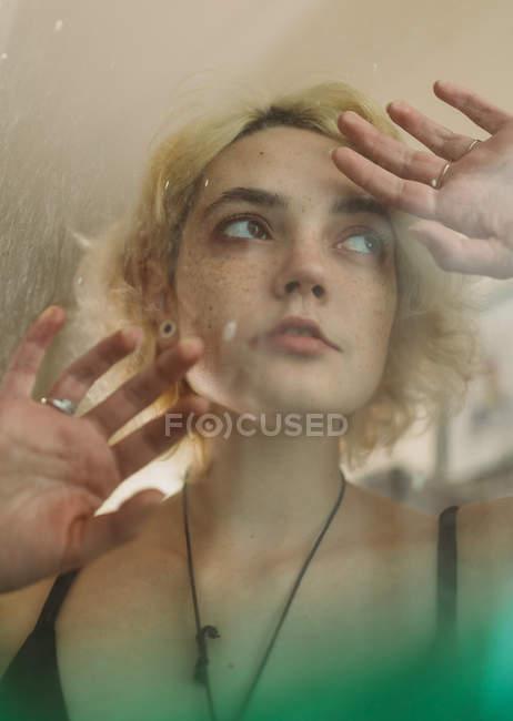 Charming melancholy woman looking away — Stock Photo