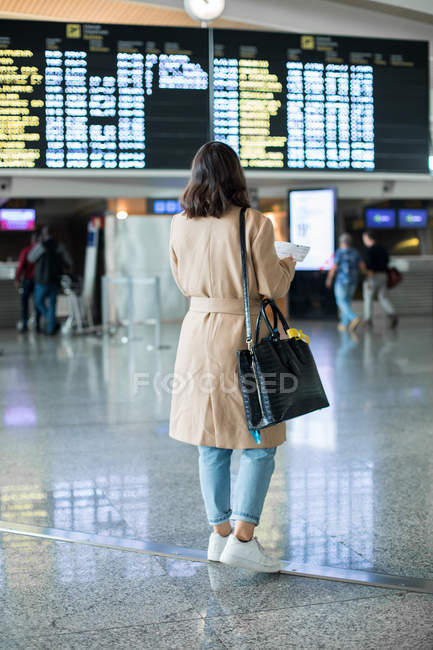 Back view of Woman standing in airport — Stock Photo