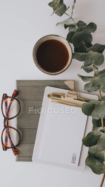 Writing accessories and drink in mug on white background — Stock Photo
