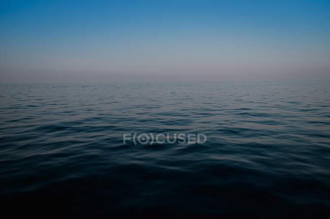 Landscape pf calmed deep blue sea in evening in nature — Stock Photo