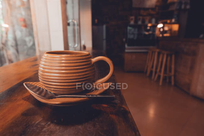 Cup of coffee on table — Stock Photo