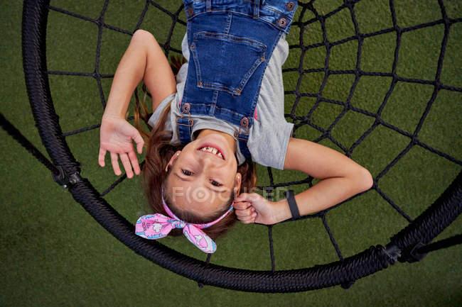 Happy girl having fun on basket swing — Stock Photo