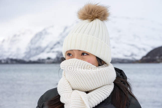 Joyful young woman in warm clothes — Stock Photo