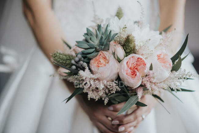 Crop woman with bridal bouquet — Stock Photo