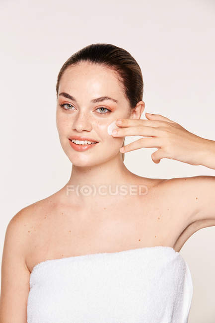 Amiable woman taking care of face — Stock Photo
