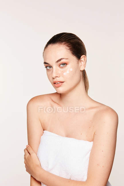 Woman with cream on face — Stock Photo