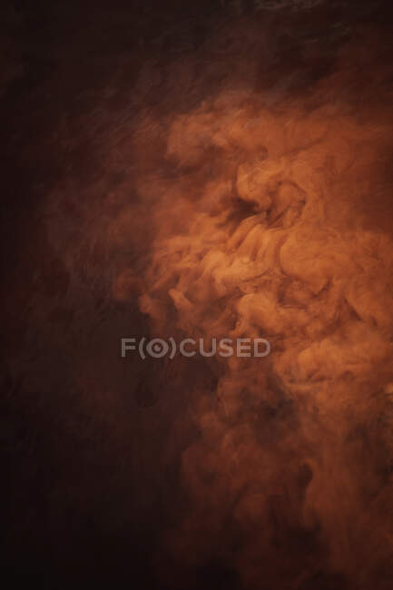 From above mysterious abstract nebula floating over moving water in brown light — Stock Photo