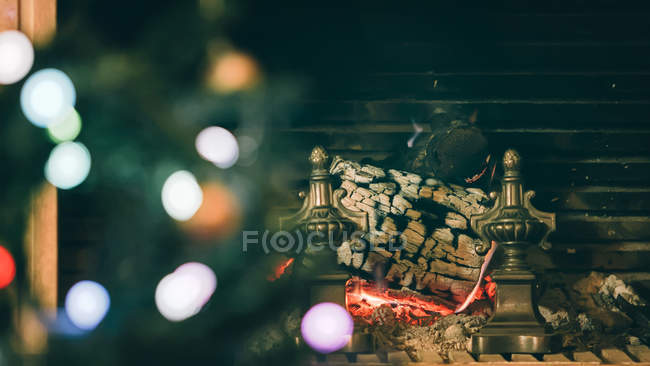 Christmas tree and fireplace in the background — Stock Photo
