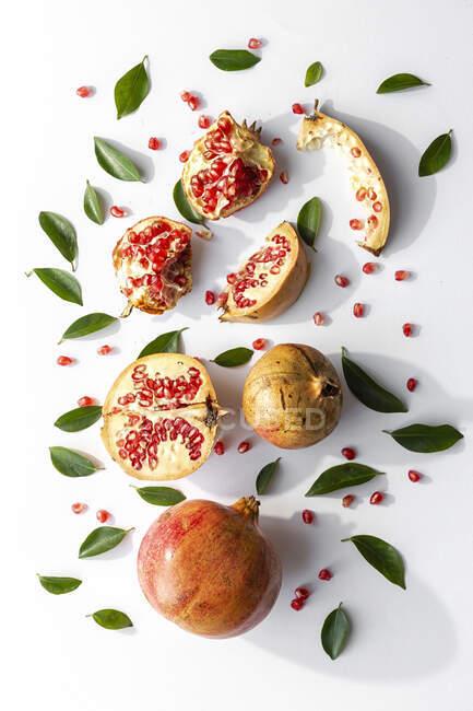 Fresh seasonal pomegranate from above on white background. Healthy food Detox. Flat lay — Stock Photo